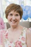 Senior Woman At Baby Shower Stock Photos