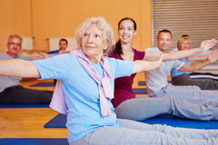 Senior woman in back training. Senior women doing gymnastics exercises in back training course in gym Stock Images