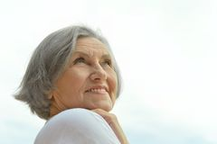 Senior woman on the background of sky Royalty Free Stock Photo