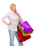 Senior woman with bags and credit card Stock Image