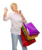 Senior woman with bags and credit card Stock Photography