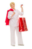 Senior woman with bags and credit card Stock Images