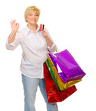 Senior woman with bags and credit card Stock Photo