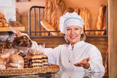 Senior woman at bakery display Royalty Free Stock Photo