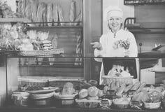 Senior woman at bakery display Royalty Free Stock Photos