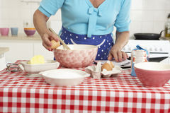 Senior Woman Baking In Kitchen Stock Photography