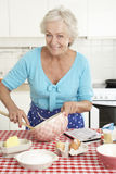 Senior Woman Baking In Kitchen Royalty Free Stock Photography
