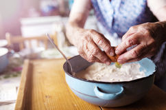 Senior woman baking Stock Images