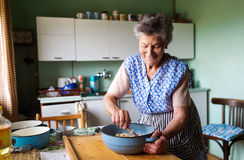 Senior woman baking Royalty Free Stock Images