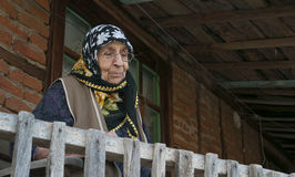 Senior woman at balcony Grandmother Old House Royalty Free Stock Photography