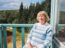 Senior woman at a balcony royalty free stock photography