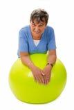 Senior woman on a ball Royalty Free Stock Photo