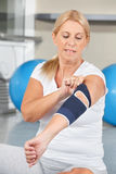 Senior woman with bandage on elbow stock images