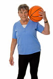 Senior woman with baskektball Royalty Free Stock Photo