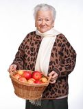 Senior woman with basket of apples Royalty Free Stock Images