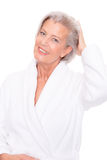 Senior woman with bathrobe Stock Photos