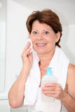 Senior woman in bathroom Stock Image