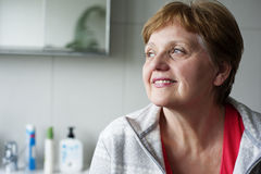 Senior woman in the bathroom Royalty Free Stock Photography