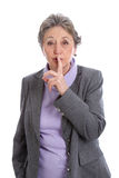 Senior woman with be quiet sign - elder woman isolated on white. Senior Woman With Finger On Lips, Be Quiet Sign Stock Photography