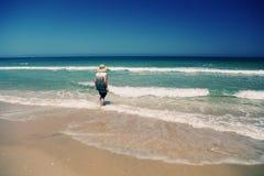 Senior woman on the beach Royalty Free Stock Photo