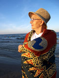 Senior Woman on Beach at Sunset Royalty Free Stock Photography