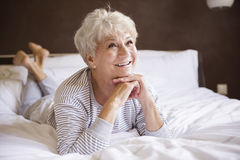 Senior woman in bed Royalty Free Stock Photos