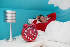 Senior woman in bed ill and suffered of sleeplessness or insomni Stock Photos