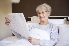 Senior woman in bed Royalty Free Stock Photo