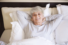 Senior woman in bed Stock Photography