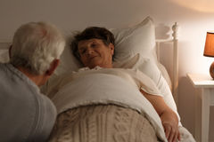Senior woman in a bed royalty free stock images