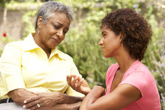 Senior Woman Being Consoled By Adult Daughter Royalty Free Stock Image