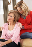 Senior Woman Being Consoled By Adult Daughter Stock Images