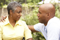 Senior Woman Being Consoled By Adult Son Royalty Free Stock Image