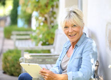 Senior woman being happy with tablet Stock Images