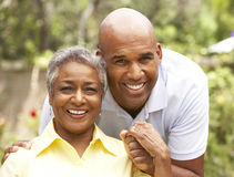 Senior Woman Being Hugged By Adult Son Royalty Free Stock Photography