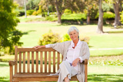 Senior woman on a bench Stock Photography