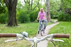Senior woman on bicycle Stock Photos