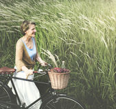 Senior Woman Bicycling Windy Park Concept Stock Photo