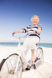 Senior woman on a bike Royalty Free Stock Photography