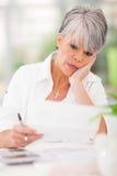 Senior woman bills Stock Images