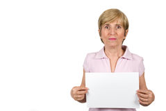 Senior woman with blank page. Cute senior woman in pink t shirt holding a blank page isolated on white background ,you can use right part of image for text Royalty Free Stock Photo