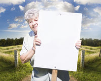 Senior woman with blank sign Royalty Free Stock Photos