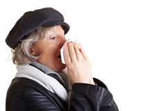 Senior woman blowing her nose Royalty Free Stock Photography
