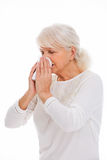 Senior woman blowing her nose Stock Images