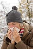 Senior woman blowing nose winter Stock Photos