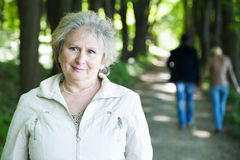 Senior woman and blurred couple Stock Image