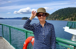 Senior woman on boat dock near ocean during nice day Royalty Free Stock Photography