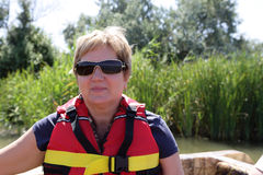 Senior woman in boat Royalty Free Stock Photo