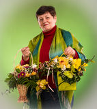 Senior woman with bouquets of flowers Stock Images
