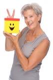 Senior woman with box Stock Photos